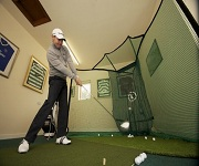 Practice golf swing at home to improve rhythm